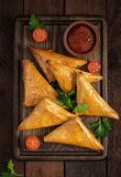 Asian food. Samsa samosas with chicken fillet and cheese. On wooden background. Top view stock photography