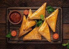 Asian food. Samsa samosas with chicken fillet and cheese. On wooden background. Top view stock photos