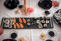 Asian food served with Japanese ginger and wasabi. At family lunch Royalty Free Stock Images