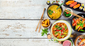 Asian food served on wooden table, top view, space for text. Asian food served on white wooden table, top view, space for text. Chinese and vietnamese cuisine Royalty Free Stock Photos
