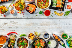 Asian food served on wooden table, top view, space for text. Asian food served on white wooden table, top view, space for text. Chinese and vietnamese cuisine Stock Photo