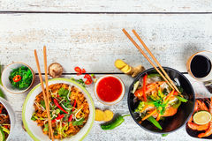 Asian food served on wooden table, top view, space for text Royalty Free Stock Image