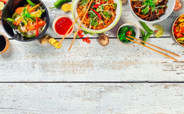 Asian food served on wooden table, top view, space for text Stock Photography