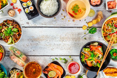 Asian food served on wooden table, top view, space for text Royalty Free Stock Photo