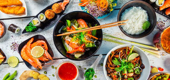 Asian food served on wooden table, top view Royalty Free Stock Photos