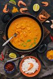 Asian food shrimp in curry sauce, rice and spices.Indian or Thai dish. View from above. Asian food shrimp in curry sauce, rice and spices.Indian or Thai dish