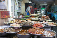 Asian food street dishes. Local restaurant in Chinatown in Bangkok, Thailand Stock Photo