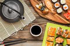 Asian food, sushi rolls, nigiri, maki with soy sauce stock images