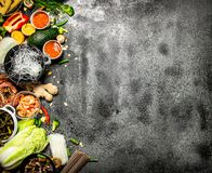 Asian food. A variety of ingredients for cooking Chinese or Thai food on a rustic background stock photography