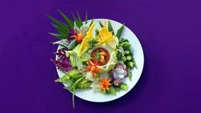 Asian food on the white plate on the purple background royalty free stock photography