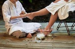 Asian foot massage therapy spa hot stone. Asian foot massage therapy spa exfoliation relaxation Royalty Free Stock Photo