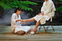 Asian foot massage therapy spa hot stone. Asian foot massage therapy spa exfoliation relaxation Stock Photography