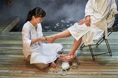Asian foot massage therapy spa hot stone. Asian foot massage therapy spa exfoliation relaxation Stock Photos