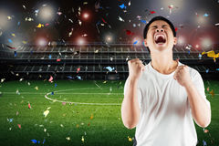 Asian football fan celebrate Royalty Free Stock Images