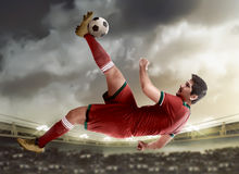 Asian football player kick ball Royalty Free Stock Image