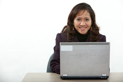 Asian forties businesswoman. Attractive asian american businesswoman on computer Royalty Free Stock Photography