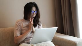 Asian freelamce woman work at home with computer excite expressi. Asian freelamce woman work at home with computer and success excite expression Stock Photos