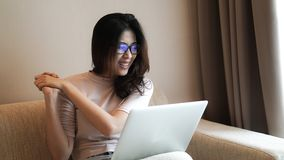 Asian freelamce woman work at home with computer excite expressi. Asian freelamce woman work at home with computer and success excite expression Stock Photography
