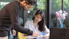 Asian freelance man and woman talking in home office stock video