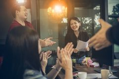 Asian freelance team meeting with happiness in modern home office royalty free stock photos