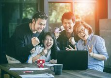 Asian freelance teamwork happiness emotion looking to laptop com royalty free stock photo