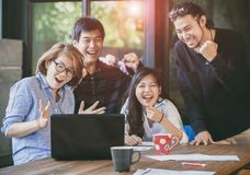 Asian freelance teamwork happiness emotion looking to laptop computer in home office royalty free stock images