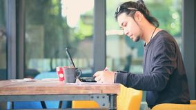 Asian freelance typing on computer laptop in home office stock footage