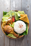 Asian fried chicken rice. Popular Indonesian local food nasi ayam penyet, indonesian fried chicken rice with sambal belacan. Fresh hot with steam smoke stock image