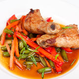 Asian fried chiken with vegetables. On the plate Stock Image