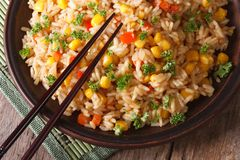 Asian fried rice with corn and eggs close-up horizontal top view Stock Photography