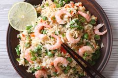 Asian fried rice with seafood closeup, horizontal top view Stock Images