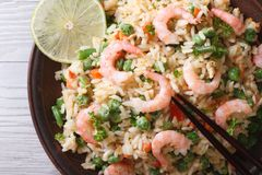 Asian fried rice with seafood macro, horizontal top view Royalty Free Stock Photography