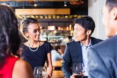 Asian friends celebrating in restaurant Royalty Free Stock Image