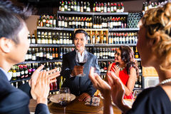 Asian friends celebrating in restaurant Royalty Free Stock Images