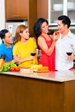 Asian friends cooking  for dinner party Stock Photo