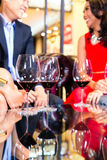 Asian Friends drinking wine in bar Royalty Free Stock Images