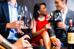 Asian Friends drinking wine in bar Royalty Free Stock Photography