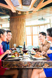 Asian Friends eating  in restaurant Royalty Free Stock Photos