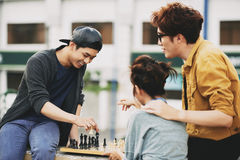 Asian Friends Playing Chess Royalty Free Stock Images