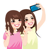 Asian Friends Selfie. Beautiful young asian japanese friends taking selfie photo together with mobile phone camera Royalty Free Stock Photography