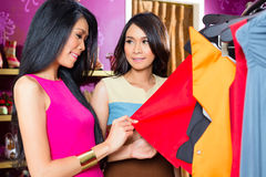 Asian friends shopping in fashion store Royalty Free Stock Images