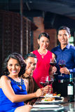 Asian Friends toasting with wine in restaurant Royalty Free Stock Photo