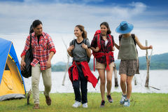 Asian friends walking in camping. And nature background, backpack, travel and adventurous concept Royalty Free Stock Photo