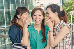 Asian friends' whisper Stock Photos