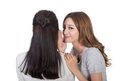 Asian friends whisper. Asian friends' whisper, full length portrait Stock Photo