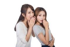 Asian friends whisper. Asian friends' whisper, full length portrait Stock Images