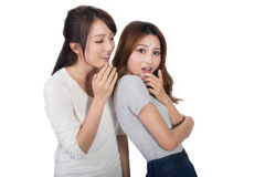 Asian friends' whisper. Full length portrait stock photo