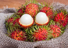 Asian fruit peeled rambutan and rambutan on sack Royalty Free Stock Images