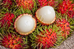 Asian fruit peeled rambutan and rambutan on sack Royalty Free Stock Image