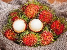 Asian fruit peeled rambutan and rambutan on sack Royalty Free Stock Photo